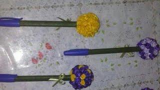 caneta decorada com flor de cetim.