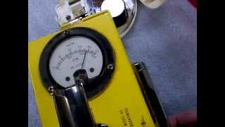 Geiger counter check source vs. smoke detector.