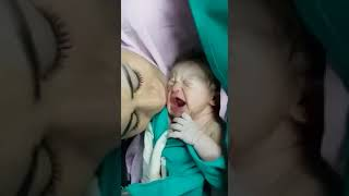 Mommy's first kiss stops baby's cry...