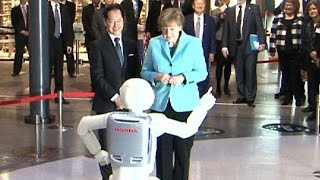 Merkel makes friends with dancing, jumping robot on Japan visit