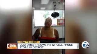 Angry woman throws fit inside cell phone store, moons camera - Detroit Michigan