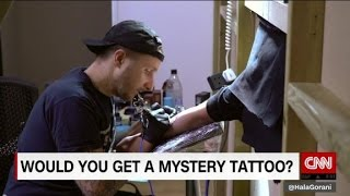 Famed tattoo artist gives away free mystery tattoos