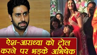 Abhishek Bachchan Lashes Out to a FAN who TROLLED Aishwarya & Aradhya Bachchan | FilmiBeat