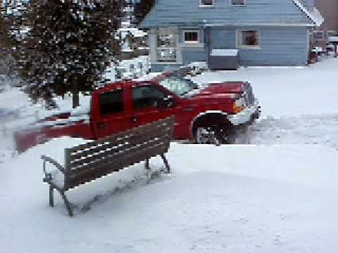 Neighbour Pat trying to get his truck up our hill after the snowstorm