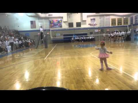 Crowd cheers for little girl at coastal Georgia volleyball game