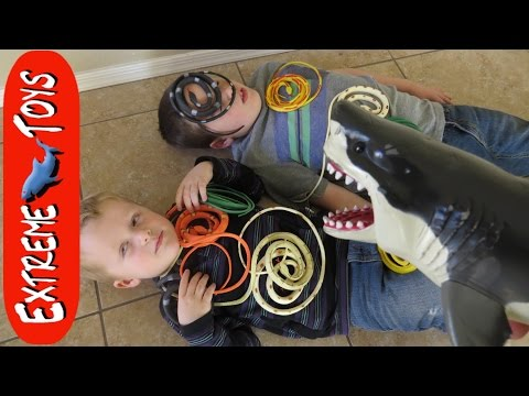 Snakes in a Box! Toy Megalodon Shark Helps Boys Fight Toy Snakes.