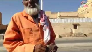 Saudi man giving gifts to the cleaners on the occasion of Eid ul Fitr. 2013