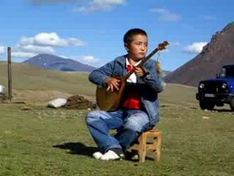 Kazak boy playing dombra