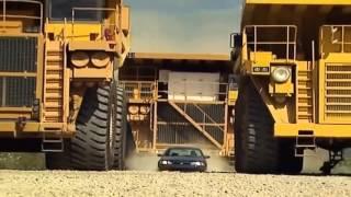 The Biggest Dump Truck in The World vs Sedan Car