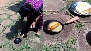 Kerala Woman cooking experiment in Hot sun