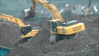 Komatsu PC450 excavator digging in loose rock