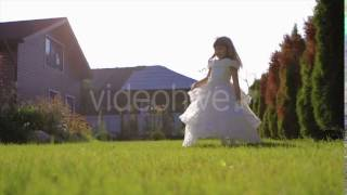 Little Girl in White Dress Dancing on the Grass Slow Motion