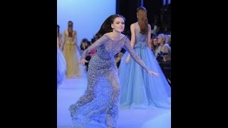 Model Jane Grybennikova falls down during Elie Saab Couture Spring/Summer 2014 TWO ANGLES OF VIEW
