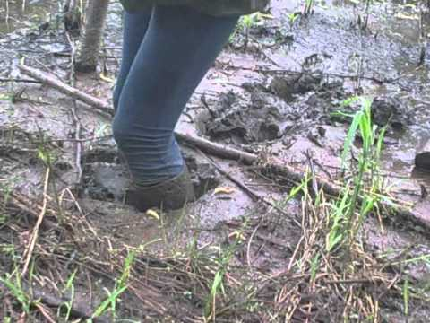 Black ridingboots in mud.mp4