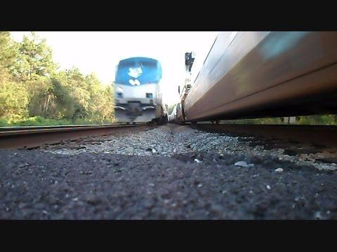 Amtrak Train Races CSX Train Knocks Over Cameras