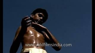 Boys gives himself oil massage prior to Kalaripayattu martial arts training