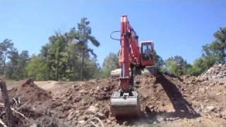 Excavator Grading Hillside