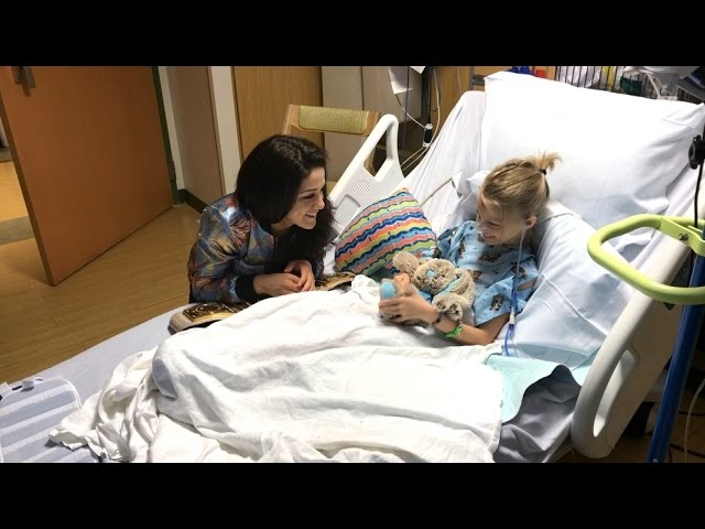Bayley meets an adorable fan at the Florida Hospital for Children
