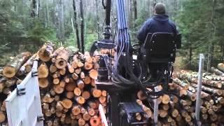 self loading Peterbilt logging truck