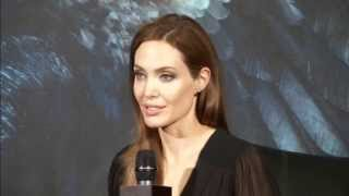 Angelina Jolie gets caught off guard by fans on Maleficent press tour