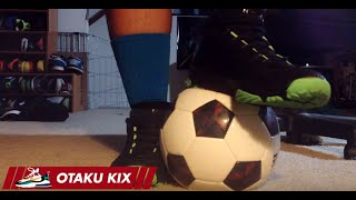 Sneakers stomping soccer ball