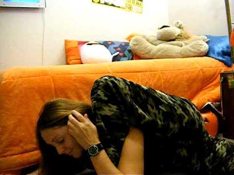 Girl Puts Feet Behind Her Head