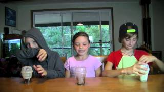 three kids doing cup song on Sunday