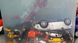 Toy cars dive in water. Toy cars jump into the water.