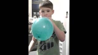Balloon face pop stunt