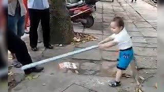 Battle! 3-Yr-Old Fights Off Corrupt Police with Steel Pipe | China Uncensored