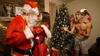 MY GIRLFRIEND KISSED SANTA CLAUS!