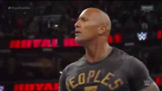 rock helps roman reigns and roman reigns wins the royal rumble