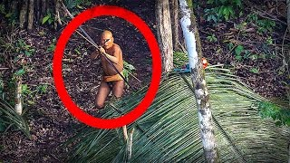 The Most Isolated Tribe in the World Shoots at Helicopter