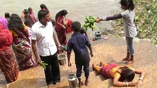 Rituals of Hindus after ganges bathing at sitala puja festival