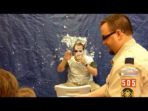Throwing a cream pie at the Cubmaster