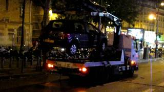 Tow Truck in Paris Lifts Car off of Ground!