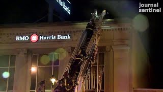 The Sherman Park civil unrest event: Firefighters work to put out bank fire