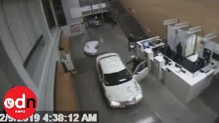 Shocking CCTV shows woman crashing car into LA police station lobby (with her baby in the back seat)