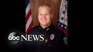 A police officer was shot and killed while in his squad car in Fayetteville, Arkansas