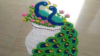 How to make beautiful couple peacock rangoli designs/peacock rangoli design easy by jyoti