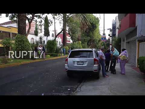 Mexico: Mexico City residents evacuate homes after quake hits Mexico's southern coast