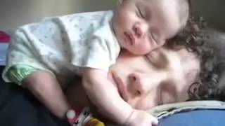 cute father and son sleep