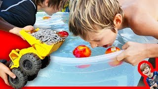 Toy Construction Trucks for Kids Clean Up + Bobbing For Apples!