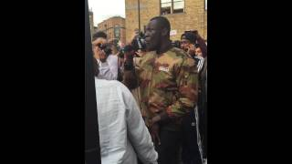 Stormzy performing 'Shut Up' with a fan outside VICE