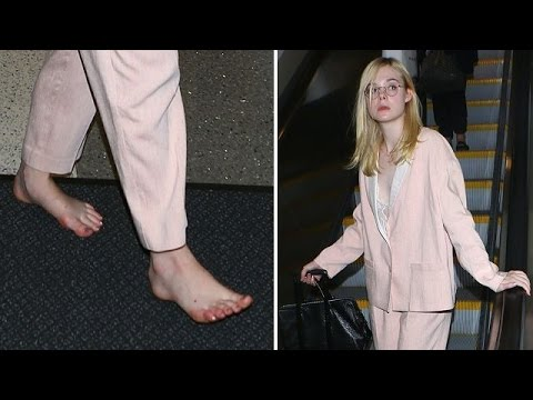 Elle Fanning Shows Off Her Funky Feet While Barefoot At LAX