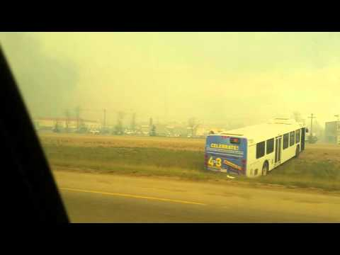 Last minutes driving out a burning nightmare of Fort McMurray