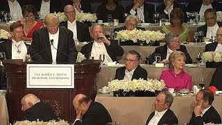 Trump booed at gala dinner as he calls Clinton corrupt