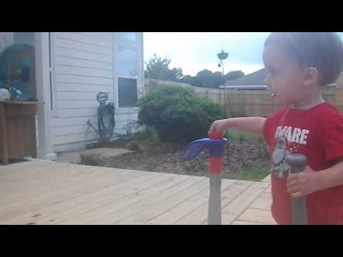 Dad teaching son how to play Baseball at 2nd birthday party!