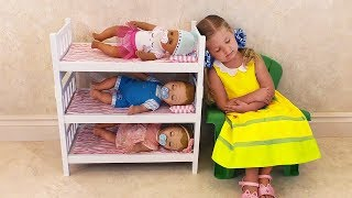 Diana - caring Mom playing with Baby Born Doll Are you sleeping