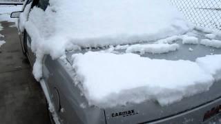 2 12 inch Kicker cvr gettin Snow off my trunk